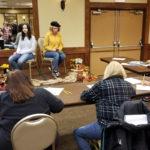 Artists sketch live models at the badlands arts show in dickinson north dakota